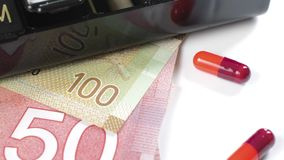 Medicine and money stock video footage