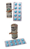 Medicine and money isolated on white Royalty Free Stock Images
