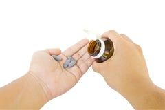 Medicine nella mano Immagini Stock
