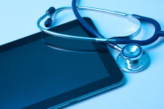 Medicine and new technology. Doctor workplace with digital tablet and stethoscope. Application of modern technology in medicine concept. You may place your own Royalty Free Stock Images