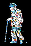 Medicine Old Man. Pills, tablets and capsules, that shape the silhouette of an old man. Isolated vector illustration on black background Stock Images