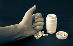 Medicine in one`s hand stock photography