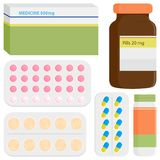 Medicine packages and pills Stock Photos