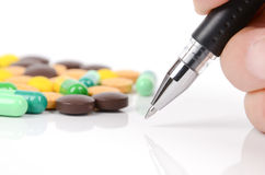 Medicine and pen Stock Images
