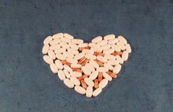 Medicine, pharmacology, the treatment of heart, capsules, pills, tablets Royalty Free Stock Photos