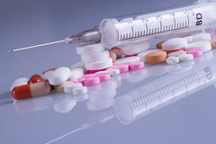 Medicine pill with injection Stock Photography