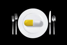 Medicine pill and table setting Stock Images