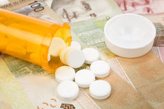 Medicine pills and canadian dollar Stock Photo
