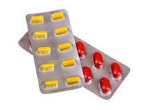 Medicine pills and capsules packed in blisters Stock Photos