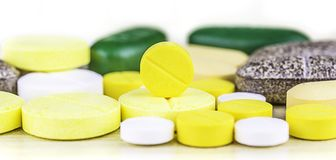 Medicine pills or capsules on wood background.Drug prescription for treatment medication.Pharmaceutical medicament,cure for health. Pharmacy theme, capsule Stock Photo