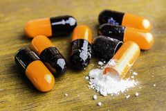 Medicine pills or capsules on wood background.Drug prescription for treatment medication.Pharmaceutical medicament,cure for health. Pharmacy theme, capsule Royalty Free Stock Image