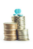 Medicine pills and coin stack Stock Photo