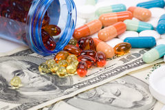 Medicine pills and dollar Stock Photo