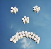 Medicine pills sad face royalty free stock photography