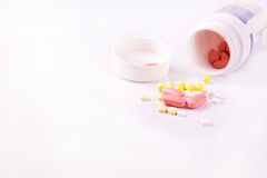 Medicine and pills scattered around Stock Photos