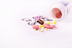 Medicine and pills scattered around Stock Photography
