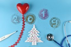 Equipment of doctor in Christmas and new years 2019 theme. royalty free stock photos