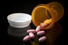 Medicine Pills Spilling out of Prescription Bottle Royalty Free Stock Image