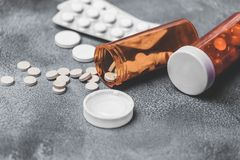 Medicine Pills and tablets with orange pill bottles for healthcare. medical help Royalty Free Stock Images
