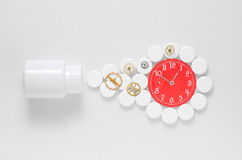 Medicine pills from a tube gear watch Royalty Free Stock Image