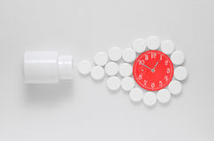Medicine pills from a tube watch Royalty Free Stock Photography