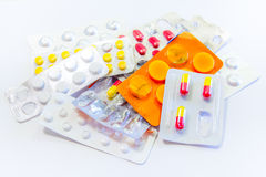 Medicine Pills. Various pills, several used packages of medicine. Trying several different medications, abandoning the treatment royalty free stock photo