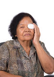 Medicine plaster patch on old woman injury wound eye. On white background stock images