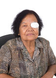 Medicine plaster patch on old woman injury wound eye. On white background stock image