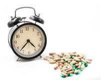 Medicine with 4pm clock. On white background Stock Photos