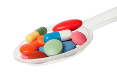 Medicine portion on spoon Royalty Free Stock Photos