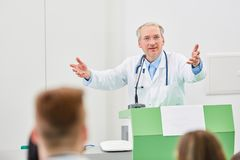 Medicine professor teach in university. During training lecture stock image