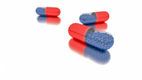 Medicine in red capsules. Stock Photography
