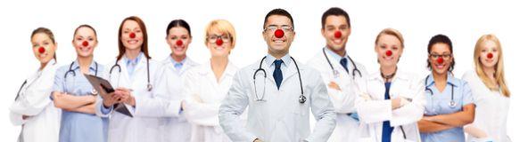 Group of smiling doctors at red nose day Stock Images