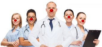 Group of smiling doctors at red nose day Stock Photos