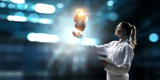 Medicine research of human heart. Mixed media royalty free stock photo