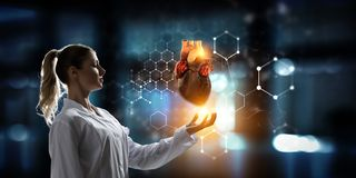 Medicine research of human heart. Mixed media stock photo