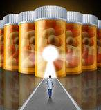 Medicine Research. Medical concept with a scientist doctor walking towards a wall made with a group of pharmaceutical prescription pill bottles with a glowing Stock Image
