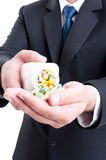 Medicine sales man rep offering pills Stock Image