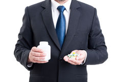Medicine sales representative. Holding pills and bottle Royalty Free Stock Photos