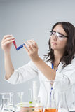 Medicine and Science Concepts. Caucasian Female Researcher Compares Substances in Two Separate Flasks Stock Photo