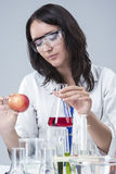 Medicine and Science Concepts and Ideas. Caucasian Female Researcher Investigating Organic Fruits Stock Photography
