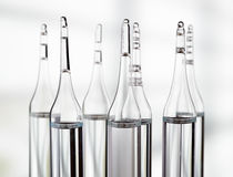 Several ampoules on light background Stock Image