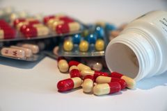 Medicine several pills red yellow blue capsules Stock Photo