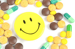 Medicine and smile face Royalty Free Stock Image
