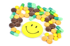 Medicine and smile face Royalty Free Stock Photography