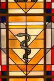 Medicine snake Symbol stained Glass window. In the city hall of Esch sur Alzette Luxembourg stock images