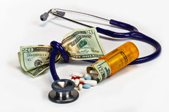 Medicine is squeezing the dollar. Stock Photos