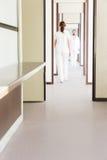 Medicine staff in corridor. Is walking while working Stock Photo