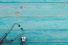 Medicine stethoscope on the blue desk Royalty Free Stock Photo