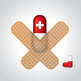 Medicine sticked to gray background with plasters. In cross shape Royalty Free Stock Photo